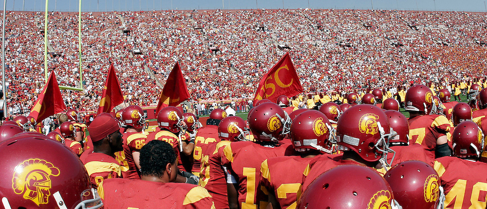 7 October 2006: Trojan Football Players run onto the field. Panoramic view.   NCAA College Football Pac-10 USC Trojans 26-6 win over the Washington Huskies at the LA Coliseum during a sunny saturday game in Los Angeles, CA.<br />