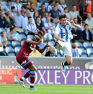 Picture by Graham Crowther/Focus Images Ltd. 07763140036.10/9/11 .Alan Lee of Huddersfield goes up with Ian Goodison  of Tranmere during the Npower League 1 game at the Galpharm Stadium, Huddersfield.