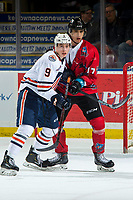 KELOWNA, BC - MARCH 09: Josh Pillar #9 of the Kamloops Blazers checks Alex Swetlikoff #17 of the Kelowna Rockets in front of the net at Prospera Place on March 9, 2019 in Kelowna, Canada. (Photo by Marissa Baecker/Getty Images)