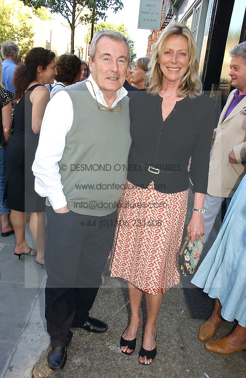 Photographer TERRY O'NEILL and his wife LARAINE at a private view of work entitles 'California' by Nigel Waymouth held at the Park Walk Gallery, 20 Park Walk, London SW3 on 12th July 2006.<br />