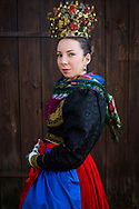 Nadine, member of the Verein f&uuml;r Heimat- und Brauchtumspflege Geldersheim e.V., is wearing an original traditional bridal costume from 1850 in Geldersheim, Upper Franconia in Germany on March 4th, 2017.<br /> <br /> The jewelry is in private ownership of the families, the dress and crown are owned by the association.<br /> <br /> This is a Werntaler tradtional costume from Geldersheim.<br /> <br /> This is part of the series about Traditional Wedding Gowns from different regions of Germany, worn by young members of local dance groups and cultural associations that exist to preserve and celebrate the cultural heritage. The portraiture series is a depiction of an old era with different social values and religious beliefs in an antiquated civil society with very few of those dresses left.