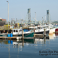 Historic Portsmouth Harbour, NH.  The state docks, fishing boats, and the Memorial Bridge in the background.<br /> <br /> All Content is Copyright of Kathie Fife Photography. Downloading, copying and using images without permission is a violation of Copyright.