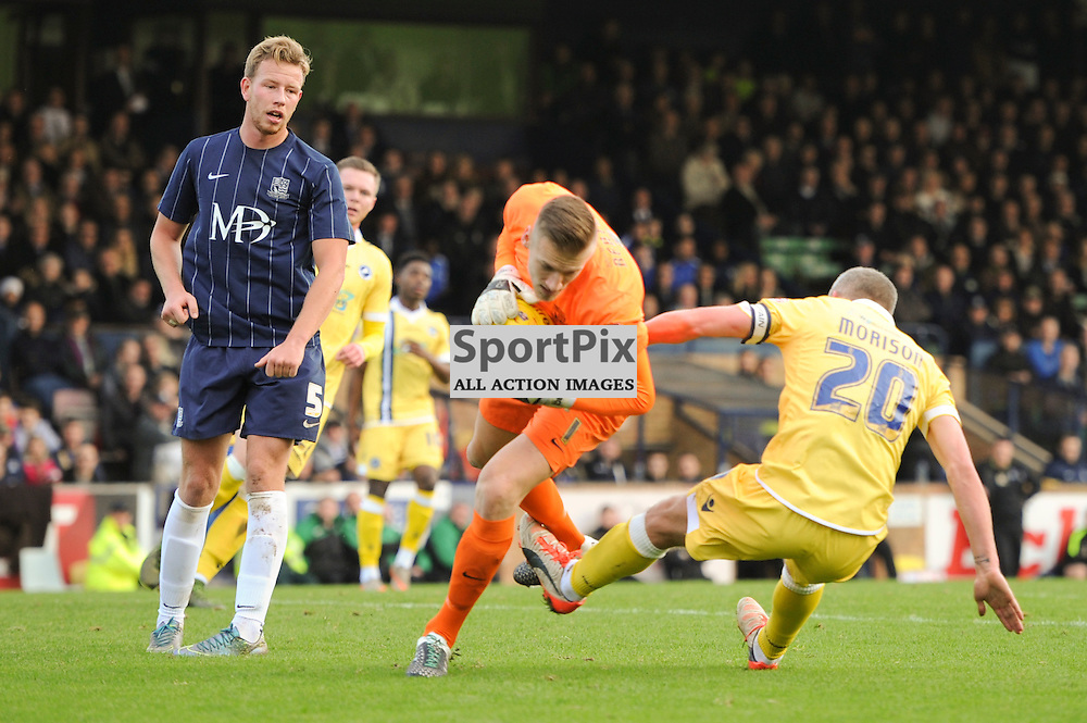 Southends Dan Bentley and Millwalls Steve Morison in action during the Southend v Millwall game in the Sky Bet League 1 on the 28th December 2015.