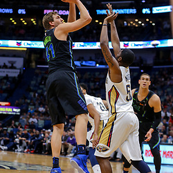 Mar 20, 2018; New Orleans, LA, USA; Dallas Mavericks center Dirk Nowitzki (41) shoots over New Orleans Pelicans forward E'Twaun Moore (55) during the first quarter at the Smoothie King Center. Mandatory Credit: Derick E. Hingle-USA TODAY Sports