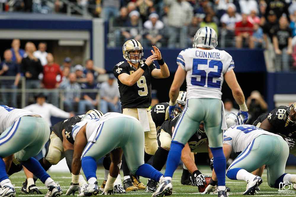 New Orleans Saints quarterback Drew Brees (9) calls a timeout against the Dallas Cowboys at Cowboys Stadium in Arlington, Texas, on December 23, 2012.  (Stan Olszewski/The Dallas Morning News)