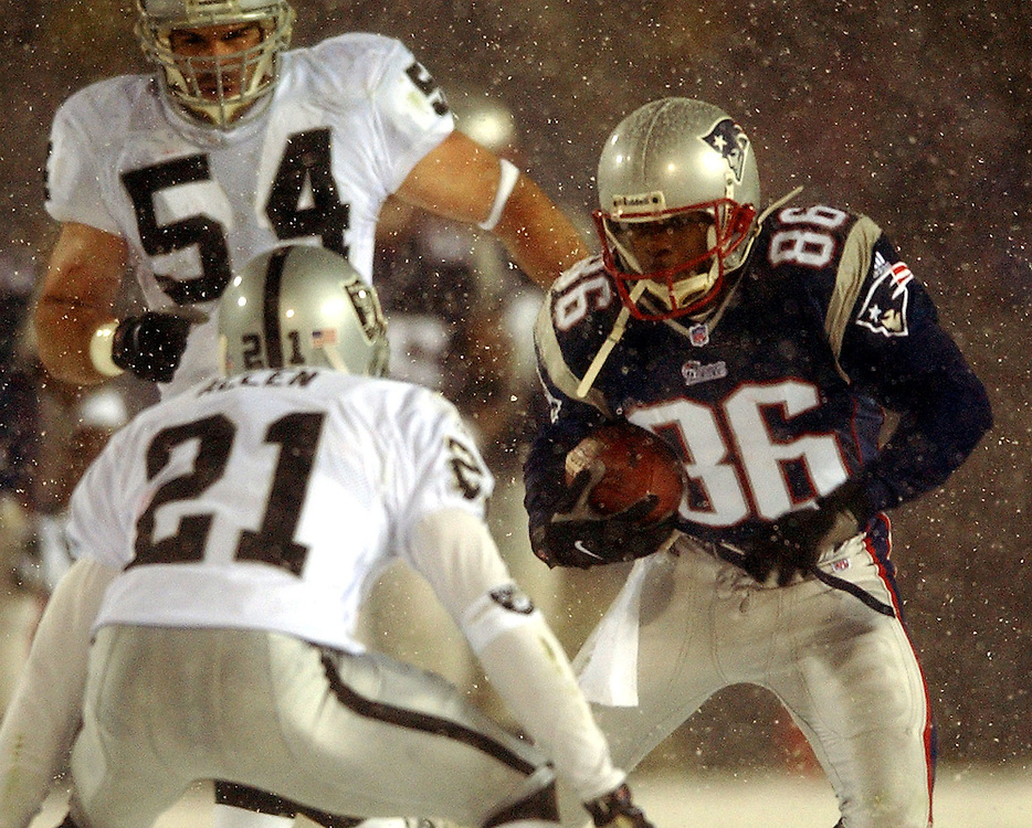 (1/19/02 Foxboro, MA) Patriots vs. Raiders at Foxboro Stadium. David Patten tries to make a move on Eric Allen after making a third Q catch. (011902patsmjs.JPG- Staff Photo by Michael Seamans. Saved in Sunday/FTP)