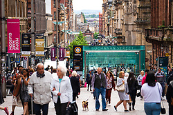 View of shoppers and shops on Buchanan Street the main pedestrian shopping street in Glasgow, Scotland, UK