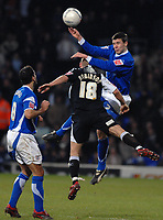 Photo: Ashley Pickering.<br />Ipswich Town v Swansea City. The FA Cup. 27/01/2007.<br />Ipswich's Owen Garvan (R) and Swansea's Andy Robinson challenge for the ball