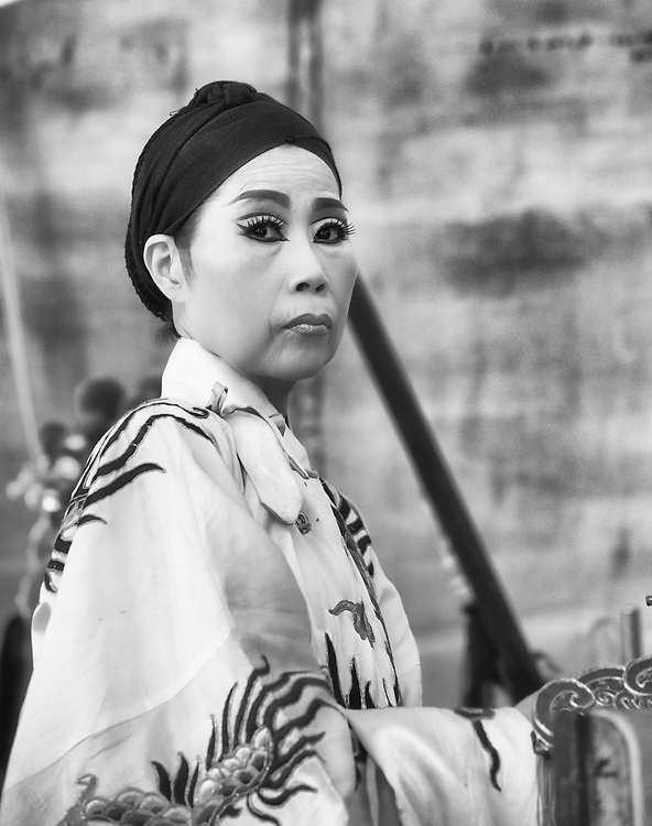 Backstage as performers make preparations before a Chinese opera drama.