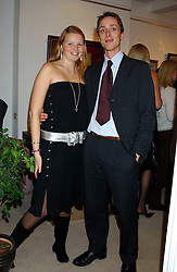 MISS VICTORIA LOWRY and NICK HOLMES at an exhibition of art by Bo Sigrist Guirey (Princess Azamat Guirey) held at Square One Gallery, 592 Kings Road, London SW6 on 13th December 2005.<br /><br />NON EXCLUSIVE - WORLD RIGHTS
