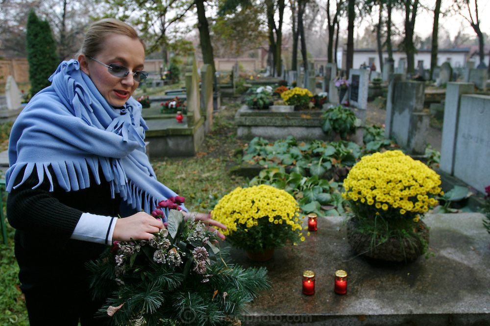 Lodz, Poland. Muslim cemetery on All Saints Day. Carina Sahek puts flowers on relatives' graves.