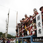 "MINAMISOMA, JAPAN - JULY 24 : Local samurai men watches the participating samurai horsemen compete in the Kacchu-keiba (armed horse race) during the Soma Nomaoi festival at Hibarigahara field on Sunday, July 24, 2016 in Minamisoma, Japan. ""Soma-Nomaoi"" is a traditional festival that recreates a samurai battle scene from more than 1,000 years ago. (Photo: Richard Atrero de Guzman/NURPhoto)"