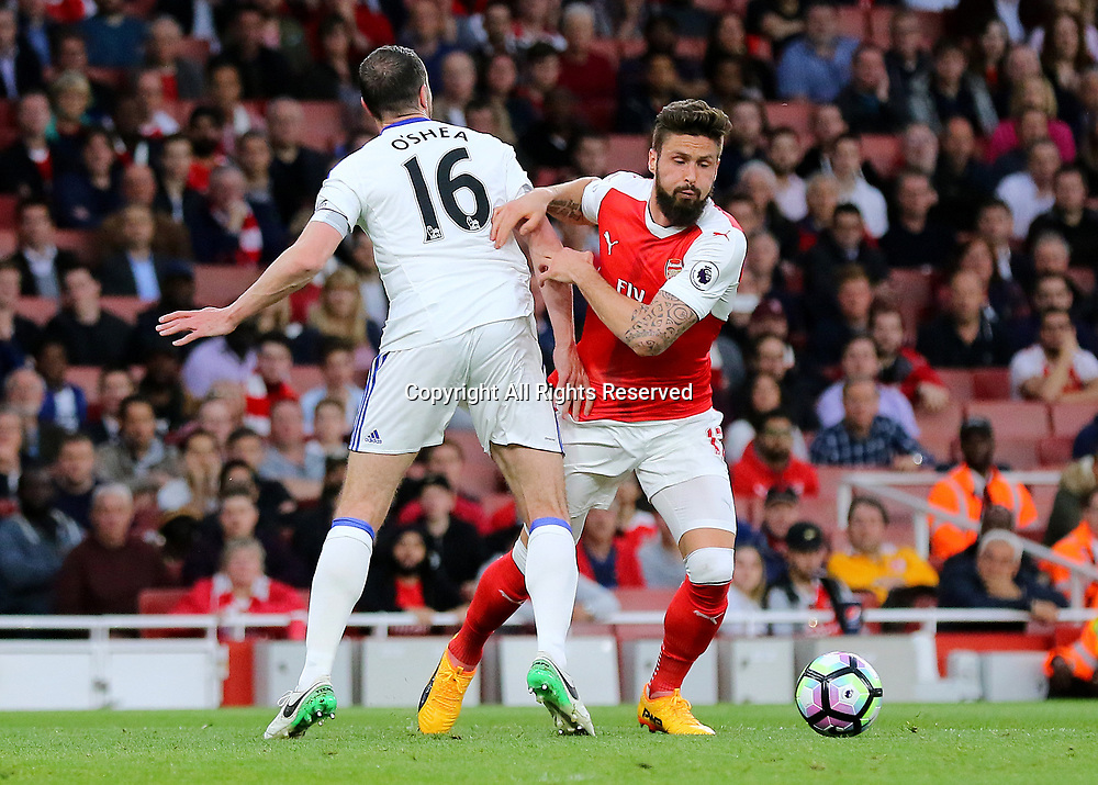 May 16th 2017, Emirates Stadium, Highbury, London, England;  EPL Premier League football, Arsenal FC versus Sunderland;  Olivier Giroud of Arsenal wrong foots John O'Shea of Sunderland, during an Arsenal attack