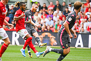 Adam Forshaw of Leeds United (4) takes a shot during the EFL Sky Bet Championship match between Bristol City and Leeds United at Ashton Gate, Bristol, England on 4 August 2019.