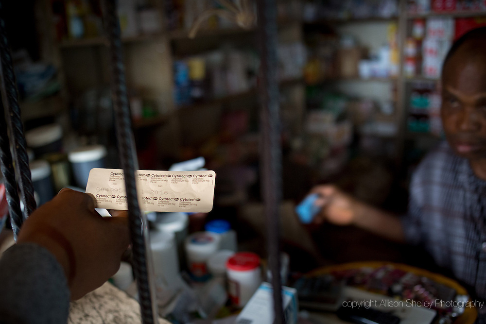 A vendor sells a customer ten 200mcg pills of the prescription drug Cytotec-- enough to induce an abortion-- over the counter at a pharmacy in the Kirikiri neighborhood of Lagos, Nigeria, August 31, 2013.  Cytotec, a trade name for the drug misoprostal, is used at lower doses to induce labor and slow post-partum bleeding, but has been widely used in higher doses for self-induced abortions in Nigeria. The ten pills cost 1,100 Naira, about $7US.