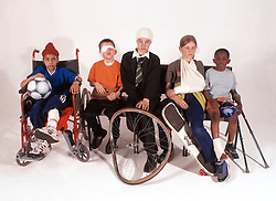 Multiracial group of children with various injuries,