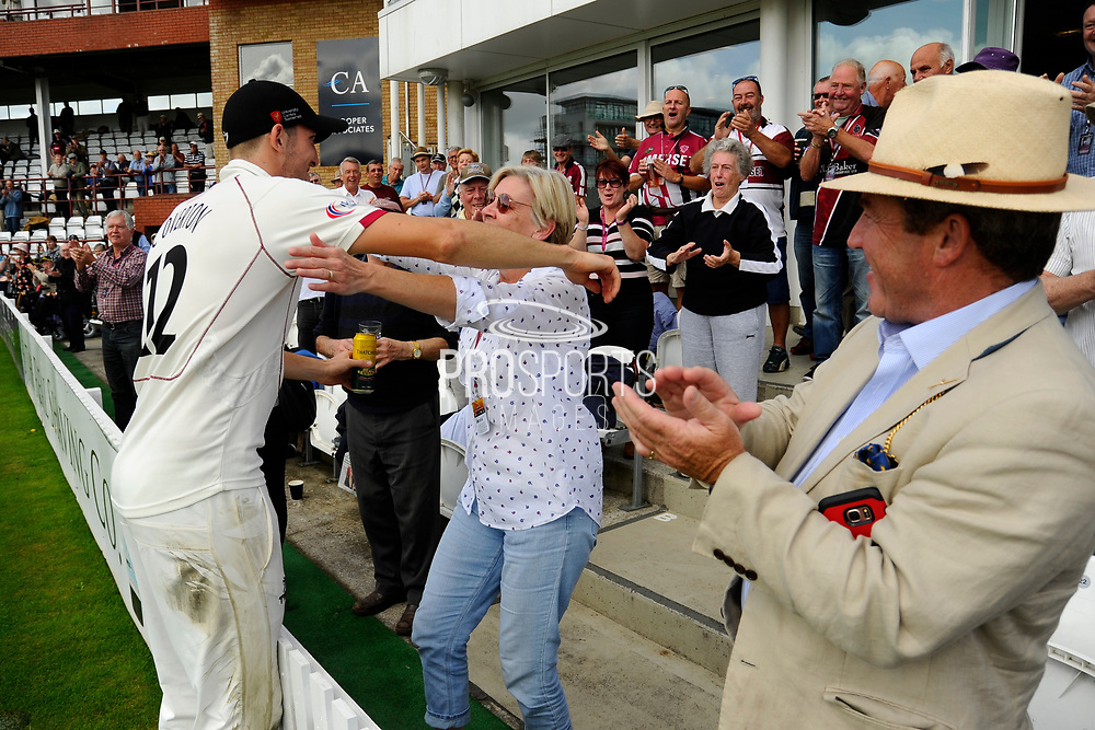Craig Overton of Somerset goes to embrace his mother while on a lap of honour after beating Middlesex to secure survival in Division 1 of the Specsavers County Champ Div 1 match between Somerset County Cricket Club and Middlesex County Cricket Club at the Cooper Associates County Ground, Taunton, United Kingdom on 28 September 2017. Photo by Graham Hunt.