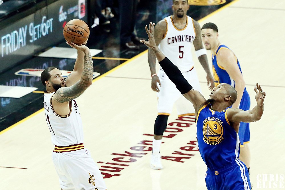 07 June 2017: Cleveland Cavaliers guard Deron Williams (31) takes a jump shot over Golden State Warriors forward David West (3) during the Golden State Warriors 118-113 victory over the Cleveland Cavaliers, in game 3 of the 2017 NBA Finals, at  the Quicken Loans Arena, Cleveland, Ohio, USA.