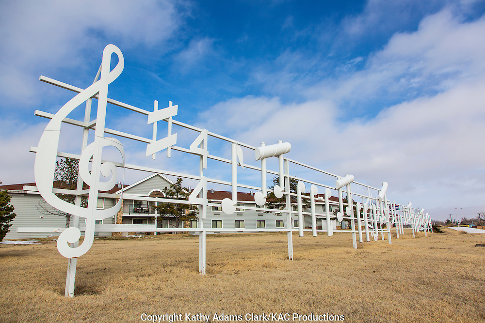 The musical note fence is the creation of artist Rusty Neef.  He made the sculpture in 1992 as a tribute to former Pampa resident Woody Guthrie.  The sculpture is located in East Coronado Park  off Highway 70  and stands 10 feet tall.