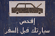 A sign in Arabic warning of breakdowns in the Western Desert, Egypt.