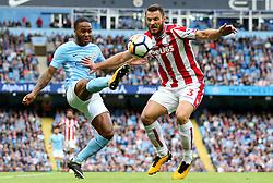 Raheem Sterling of Manchester City challenges Erik Pieters of Stoke City - Mandatory by-line: Matt McNulty/JMP - 14/10/2017 - FOOTBALL - Etihad Stadium - Manchester, England - Manchester City v Stoke City - Premier League