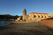 Eglise Notre Dame des Anges, Collioure, France, and Chateau Royal in the background. The bell tower was converted from a medieval lighthouse and the Mediterranean Gothic style nave was built in 1684. The dome was added to the bell tower in 1810. Picasso, Matisse, Derain, Dufy, Chagall, Marquet, and many others immortalized the small Catalan harbour in their works. Picture by Manuel Cohen.