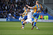 Jack Grimmer of Shrewsbury Town squeezes a pass past Michael Brown of Port Vale FC  during the Sky Bet League 1 match between Shrewsbury Town and Port Vale at Greenhous Meadow, Shrewsbury, England on 25 March 2016. Photo by Mike Sheridan.