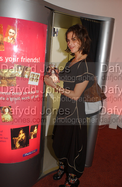 Tracey Emin in the Art Fund Centenary Photo Me machine. Art 2003 London Art Fair opening. Business Design Centre.  14 January 2003. © Copyright Photograph by Dafydd Jones 66 Stockwell Park Rd. London SW9 0DA Tel 020 7733 0108 www.dafjones.com