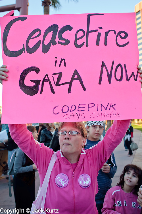 30 DECEMBER 2008 -- PHOENIX, AZ: LIZ HOURICAN, from Phoenix, a member of Code Pink, marches in support of Palestinian rights in Phoenix Tuesday. About 200 people from a variety of human rights and peace activists organizations in Phoenix, AZ, marched in opposition to the Israeli attacks on Gaza and in favor of Palestinian rights on Tuesday, the fourth day of Israeli air strikes on Hamas facilities in Gaza. Photo by Jack Kurtz / ZUMA Press