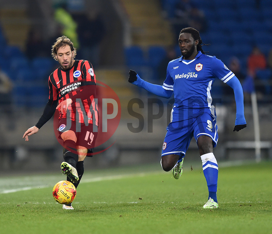 Cardiff City's Kenwyne Jones chases Brighton and Hove Albion's Inigo Calderon - Photo mandatory by-line: Paul Knight/JMP - Mobile: 07966 386802 - 10/02/2015 - SPORT - Football - Cardiff - Cardiff City Stadium - Cardiff City v Brighton & Hove Albion - Sky Bet Championship