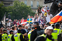 © Licensed to London News Pictures. 14/07/2018. London, UK. Supporters of EDL founder Tommy Robinson ( real name Stephen Yaxley-Lennon ) and US President Donald Trump at Trafalgar Square during a day of demonstrations and rallies in support and opposed to US President Donald Trump and jailed EDL founder Tommy Robinson . Trump is currently in Scotland and Robinson is in HMP Hull . Photo credit: Joel Goodman/LNP