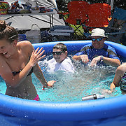 The Lamham family from Ocala, Florida plays in the pool prior to the 57th Annual NASCAR Coke Zero 400 stock car race at Daytona International Speedway on Sunday, July 5, 2015 in Daytona Beach, Florida.  (AP Photo/Alex Menendez)