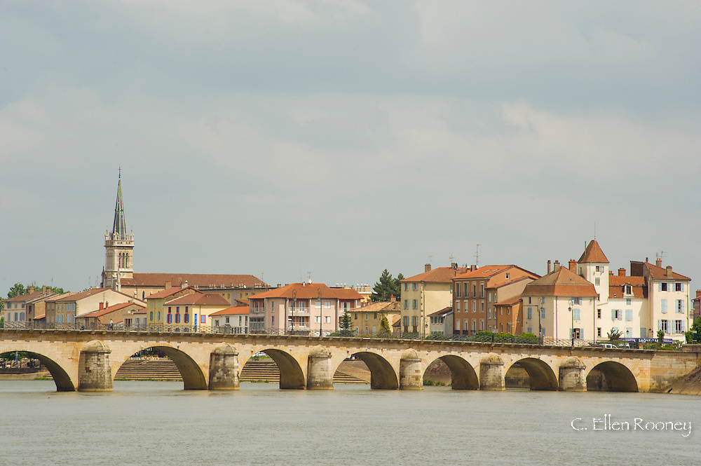 An old arched bridge across the Saone River in Macon, France