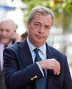 © Licensed to London News Pictures. 29/08/2014. Clacton-on-Sea, UK Douglas Carswell and Nigel Farage (pictured) Leader of the UK Independence Party, UKIP, meet local people on a walk about in Clacton-on-Sea today 29th August 2014. Tory Douglas Carswell  defected to UKIP and quit as MP for Clacton, saying he will contest the subsequent by-election for Nigel Farage's party.. Photo credit : Stephen Simpson/LNP