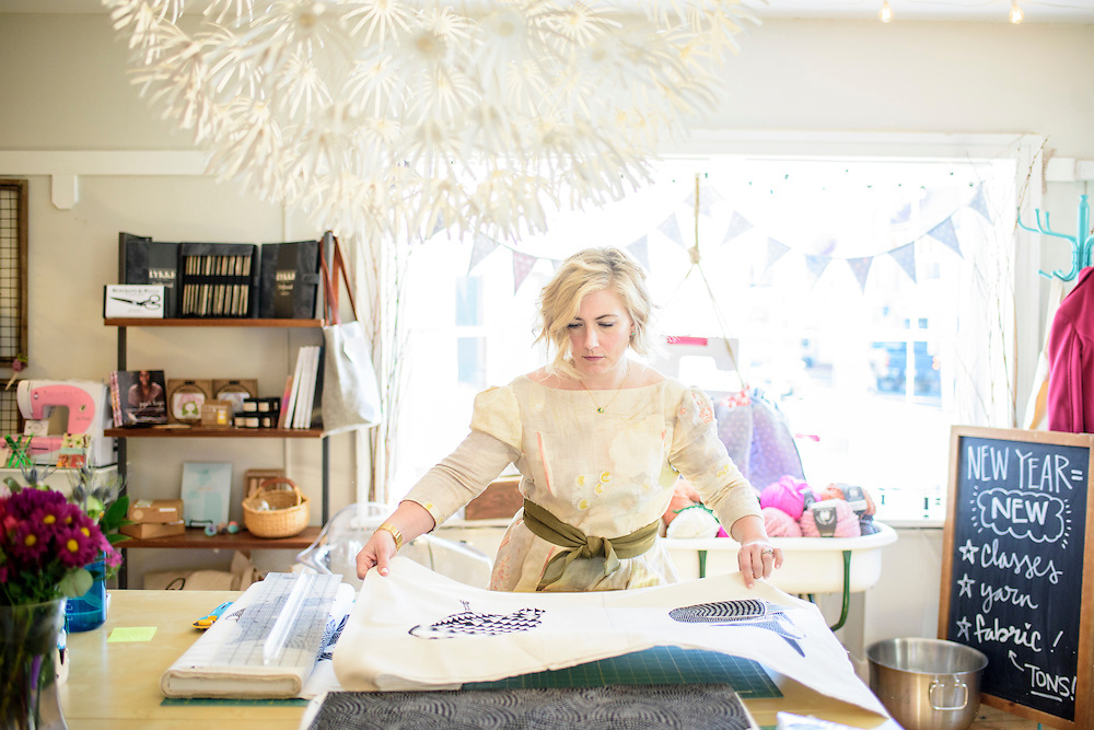 Leesburg, Virginia - February 13, 2017: Nicole Morgenthau, owner of Finch Knitting + Sewing Studio in Leesburg, Va., cuts a customer's fabric Monday February 13, 2017.<br /> <br /> In January Morganthau received a Pro-Trump email threatening a boycott of her store. She posted the note on her store's Facebook page. The response was an outpour of support for Morganthau and an increase in business.<br /> <br /> <br /> CREDIT: Matt Roth for The New York Times<br /> Assignment ID: 30202692A