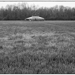 Barns like these disappear when the crops are high and reappear when they are low.