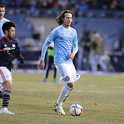 Lee Nguyen, (left), New England Revolution, challenges Mix Diskerud, NYCFC, during the New York City FC v New England Revolution, inaugural MSL football match at Yankee Stadium, The Bronx, New York,  USA. 15th March 2015. Photo Tim Clayton