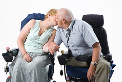 Disabled couple holding hands and kissing,