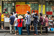 11 SEPTEMBER 2013 - BANGKOK, THAILAND:  People line up and wait to be served at a curry stand in the Chinatown section of Bangkok. Thailand in general, and Bangkok in particular, has a vibrant tradition of street food and eating on the run. In recent years, Bangkok's street food has become something of an international landmark and is being written about in glossy travel magazines and in the pages of the New York Times.        PHOTO BY JACK KURTZ