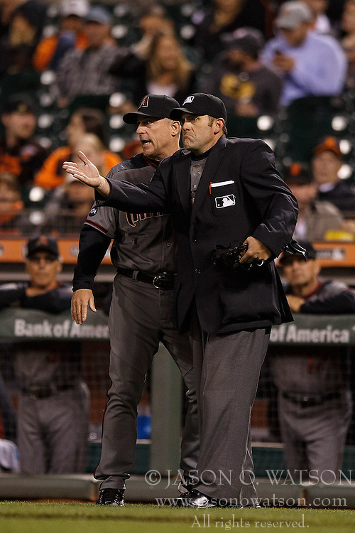 SAN FRANCISCO, CA - APRIL 18: Chip Hale #3 of the Arizona Diamondbacks asks umpire Brian Knight #91 for a video review on a play against the San Francisco Giants during the seventh inning at AT&T Park on April 18, 2016 in San Francisco, California. The Arizona Diamondbacks defeated the San Francisco Giants 9-7 in 11 innings.  (Photo by Jason O. Watson/Getty Images) *** Local Caption *** Chip Hale; Brian Knight