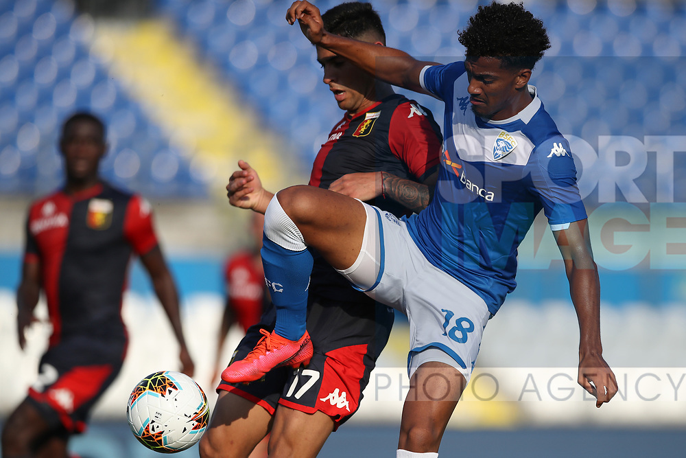 Brescia Calcio's French striker Florian Aye clashes with Genoa's Argentinian defender Cristian Romero during the Serie A match at Stadio Mario Rigamonti, Brescia. Picture date: 27th June 2020. Picture credit should read: Jonathan Moscrop/Sportimage