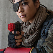 Cosplay attendee in her 7th Lotus Big Boss costume, with eye patch and metal gear <br />
