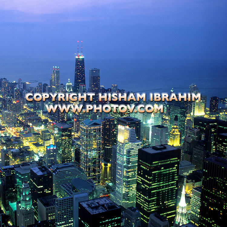 Aerial view of Chicago illuminated at night, Chicago, Illinois, USA.