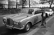 Nev and Gary next to Rolls Royce, Palmers Green, London, UK, 1980s.
