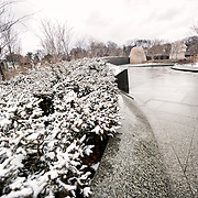Recent snowfall has left snow on the areas surrounding the Martin Luther King Memorial in Washington DC next to the Tidal Basin.
