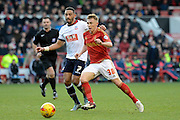 Nottingham Forest midfielder Ben Osborn and Bolton Wanderers midfielder Liam Feeney tussle during the Sky Bet Championship match between Nottingham Forest and Bolton Wanderers at the City Ground, Nottingham, England on 16 January 2016. Photo by Alan Franklin.