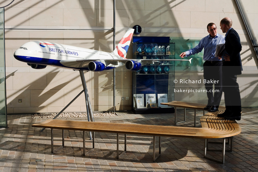 British Airways' Chairman, Willie Walsh shows writer Alain de Botton their A380 model at the company's Waterside corporate HQ