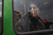 A woman look at the window of a tram Tunisians who protest against the partecipation of the Constitutional Democratic Rally, RCD, party of Ben Ali, to the national unity government.