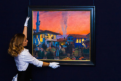 "Sotheby's, London, November 21st 2014.  Sotheby's presents one of its strongest offerings of Russian paintings, icons and artworks as the renowned fine art  auction house celebrates its 25th year in Russia. Pictured: A sotheby's gallery technician straightens Boris Kustodiev's ""Bakhchisarai"", and oil on canvas painting, described as the most impressive pre-revolutionary painting by Kustodiev to come to light in recent memory. It is expected to fetch between £1.2 and £1.8 million at auction."