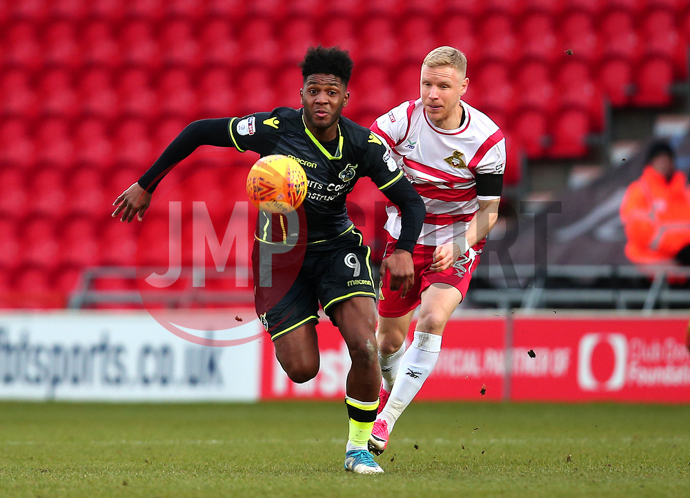 Ellis Harrison of Bristol Rovers goes past Craig Alcock of Doncaster Rovers - Mandatory by-line: Robbie Stephenson/JMP - 27/01/2018 - FOOTBALL - The Keepmoat Stadium - Doncaster, England - Doncaster Rovers v Bristol Rovers - Sky Bet League One
